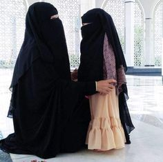 Smiling Mother and Daughter in a Masjid