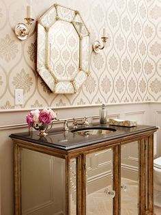 Powder rooms are typically small by nature, making them wonderful places to experiment with bold wall treatments and eye-catching color: http://www.bhg.com/bathroom/small/solutions/?socsrc=bhgpin033115glitzandglam&page=14