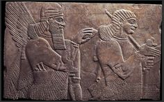 Assyrian Relief Depicting a Winged, Human Headed Genius and a Royal Attendant, 883-859 BCE, reign of King Ashurnasirpal II. Found in Room C of the Northwest Palace at Kalhu (now Nimrud) on the banks of the Tigris.