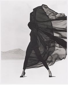 "10 Iconic Fashion Photos That Redefine ""Power Pose"" #refinery29  http://www.refinery29.com/herb-ritts-fashion-photography#slide-5  ""Versace Veiled Dress, El Mirage"" (1990)"