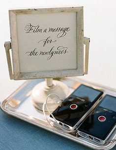 For the modern, tech-savvy couple! An electronic guest book, such as an ipad or compact video recorder, is a fun way for guests to interact and a great alternative if you don't have a videographer but still want to capture video mementos.