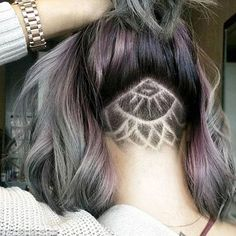 Sneaky: The 'tattoos' mean that when the hair is pulled up into a ponytail or bun you can see the design, but it remains hidden when the hair is down