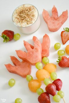 Celebrate the back to school season with this easy dinosaur snack idea with dinosaur footprints! Kids will love these fun dino fruit skewers with yogurt fruit dip inspired by #WeDontEatOurClassmates, a humorous children's book by Ryan T. Higgins. (This post is in partnership with Disney Book Group.) #snacks #snacktime #fruit #kidfriendly #backtoschool #fruitdip #easyrecipes #dinosaur #dinos #dinosaurparty