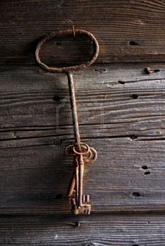Picture of antique keys on an old wooden doors stock photo, images and stock photography.