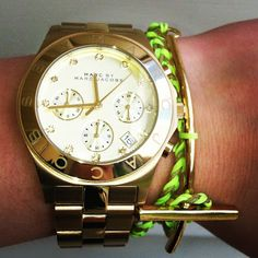 Marc jacobs gold watch with a neon bracelet. Gold and neon going well together!