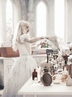 The White Queen, Alice in Wonderland Picture of her magic laboratory, all white interior with odd and vintage stuff.