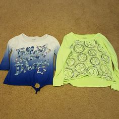 2 Justice tops (1 ) Follow your Dreams top with mid length sleeves in size 10. (2) Florescent green peace top in size 10. Both have sequins in their design. In good condition! Justice Tops Tees - Long Sleeve