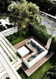 A bird's eye view of the outdoor area shows the angular shapes formed by the balcony edges, platform base and outdoor sectional sofa. All of the decor is waterproof, a necessity in humid and typhoon-prone Hong Kong Modern Exterior, Interior Exterior, Exterior Design, Outdoor Spaces, Indoor Outdoor, Outdoor Living, Outdoor Decor, Outdoor Projects, Landscape Design