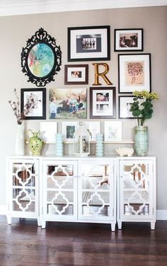 Gallery Wall inspiration- I like the mixture of matching/not matching frames and the circular shape.
