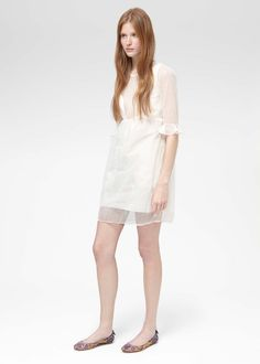 Carven - Resort 2013.  White, covered, yet shear.  A great summer piece.