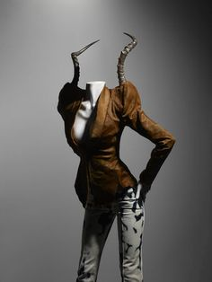 * Alexander McQueen (British, 1969–2010); Ensemble It's a Jungle Out There, autumn/winter 1997–98.Jacket of brown pony skin with impala horns; trousers of bleached denim. Photo Sølve Sundsbø