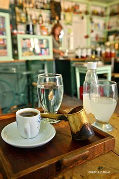 "This is my Greece | A cup of greek coffee and homemade ""Tsitsibira"" (""Ginger beer"") at the traditional kafeneio of Bournaos at Magazia village, Paxos island, Ionian sea"