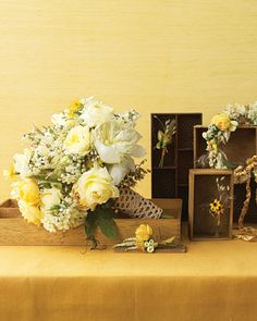 roses, peonies, wheat, astilbe, button mums, Deutzia rosea, passion vine, oak leaf, hydrangea, and yarrow is dominated by creamy white with pale-yellow accents and shot through with gold.