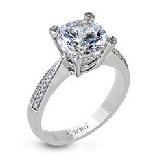 This impressive 18k white gold engagement ring features .25 ctw of white round diamonds in a basket setting. Print Page