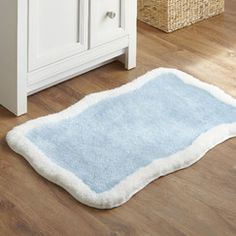 Taffy Bath Mat | Soft pile, sweet colors, and a silly, squiggly shape makes this mat a fun addition to your child's bathroom.