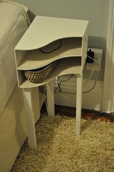 DIY bedside table by conan. Magazine holder on side. Paint in colour to match décor. Would also be useful in a bathroom if you're someone who likes reading material in there!