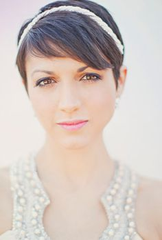 Brides.com: Wedding Hairstyles for Brides with Short Hair. A Pixie Hairstyle Accessorized with Headband | Photo credit: Our Labor of Love