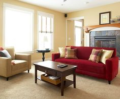 Living rooms serve many functions in a home, so it's important to find the right arrangement to handle family time and visiting guests. In three stages, we transform this living room from awkward and bland to fully functional by improving traffic flow, highlighting focal points, and adding a splash of color.