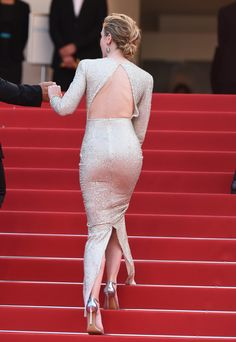 Emily Blunt booty navigating the Cannes red carpet stairs in sexy high heels she wishes were sneakers.