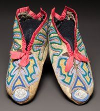 A PAIR OF SOUTHEAST BEADED HIDE MOCCASINS c. 1830