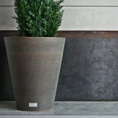 Contemporary yet versatile the KOBO design is the perfect planter for all settings, indoors and out. Characterized by a grooved finish and contemporary round tapered design, the Kobo planter is ideal as a backyard deck accent or as an entrance stateme Resin Planters, Plastic Planter, Outdoor Planters, Planter Pots, Modern Planters, Concrete Planters, Commercial Planters, Powder Coating Process, Mould Design