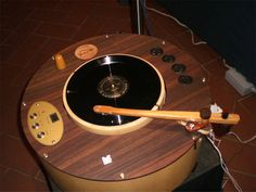 """The """"R-evolution"""" turntable by Audio Consulting This turntable is made of wood only. It is battery powered thus totally freed from mains problems. Power consumption is below 4 watts. Even the active cooling of some of the parts is battery powered as this has a very clear impact on the sound."""