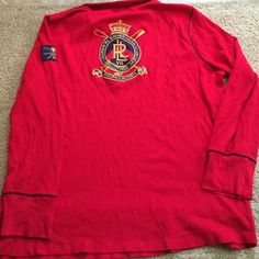 Ralph Lauren shirt crest appliqué red/navy 2x Lauren Active by Ralph Lauren lightweight thermal long sleeve top. Zipper at neck in front and crest appliqué on back of shirt also on left upper shoulder. Worn 2-3 x. .... 27in long. 23in armpit to armpit across front.  Red/navy size 2x....Excellent shape from a pet free and smoke free home Ralph Lauren Sweaters