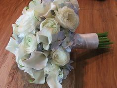 really pretty, but I am not a fan of the blue hydrangea....change it to white and white the white rannunculus and callas....mmm