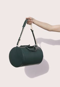 Trendy Handbags and Purses : Picture Description Building Block Cylinder Duffle in Green Leather Purses, Leather Bag, Green Leather, My Bags, Purses And Bags, Duffle, Duffel Bag, Minimalist Bag, Trendy Handbags