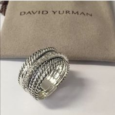 David Yurman Crossover W/ Diamonds sterling silver Pavè diamonds David Yurman crossover diamond ring 0.18 total carat weight ring size 7.75 ( can be resized for free) Amazing Condition! Recently cleaned at David Yurman store. Total with Tax: $952.88 (retail) David Yurman Jewelry Rings