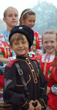 Children are dressed in the traditional costumes of Russian Cossacks.