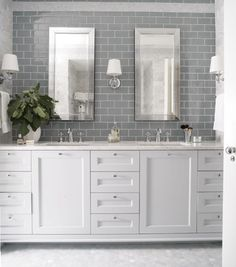 grey subway tiles + penny tile on the floor + white cabinets