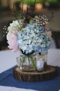 babybreath, hydrangea centerpieces...take out pink and add white hydrangeas and dusty miller and/or seeded eucalyptus