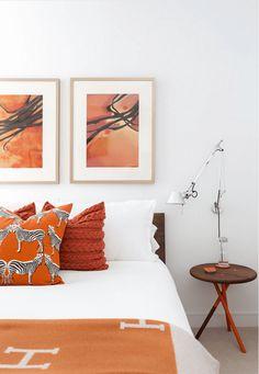 white bedroom with burnt orange accents, blood orange, reddish-orange, tangerine orange, burnt orange, pantone autumn maple