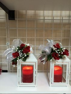 I made these 2 lanterns with red roses, silver and white ribbons, added a red LED candle in each lantern as the finishing touch for this 25th Wedding Anniversary!!