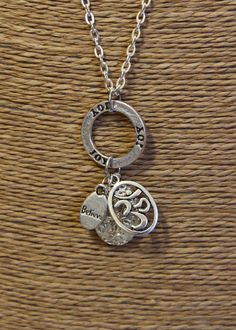 Diffuser Necklace with Silver Locket Decorated with Joy, Ohm & Believe Charms