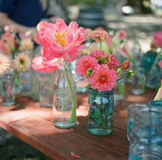 love the way these jars and flowers look@Emily Kelly