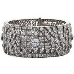 Okrant et Davidonniez Art Deco Diamond Platinum Extra Wide Bracelet   From a unique collection of vintage more bracelets at https://www.1stdibs.com/jewelry/bracelets/more-bracelets/