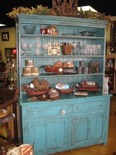 lots of storage hutch...something like this for your dining room.  bottom can be art supplies