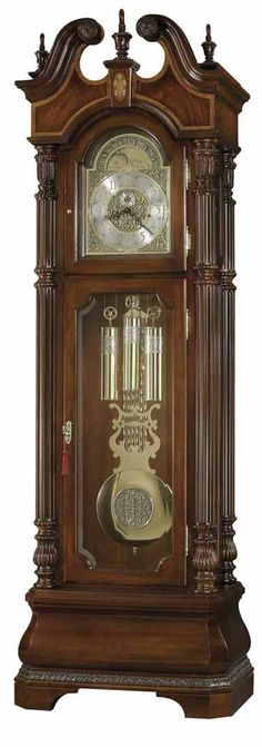 """<p> This grand Presidential Grandfather Clock has many outstanding features. The swan neck pediment displays bookmatched crotch figured veneers. The pediment is further enhanced with three turned urn finials, carved rosettes, and an inlaid keystone with the """"Prince of Wales"""" motif using Maple, Padauk, Amaranth, and Ebony veneers on a Madrona burl background.%..."""