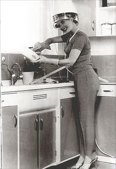 The 1950s-Busy housewife. Right after this photograph was taken, you heard. BZZZZZZZZZ. Those high heels went a'flyin' :D