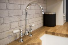 Rangemaster contemporary white ceramic sink and traditional bridge mixer tap. Part of a Hammonds beautiful fitted kitchen.