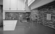 Grey Granite Countertop Connected By Stainless Steel Curved Faucet And Grey Mozaic Tile Backsplash Elegant Grey Granite Countertops for Better Kitchen Makeover grey granite countertops with brown cabinets. dark gray granite. dark grey granite countertops.