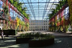 MFO Park, Zurich, Switzerland     The steel structural facade houses an interior courtyard garden and elevated walkway while creating a historical link to Zurich's industrial heritage.  The facade is colonised by numerous species of climbers, vines and shrubs.  The plant species is split between a mixture of deciduous, semi-evergreen and evergreen; this allows for precious sunlight to penetrate into the interior courtyard garden providing warmth during winter.