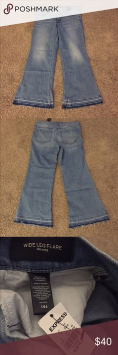 Express wide leg flare jeans. Size 14 Short Express wide leg flare  Mid Rise. Size 14 Short. New with tags Express Jeans Flare & Wide Leg