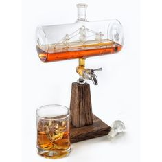 This cool all glass ship in a bottle is a whiskey decanter and dispenser that will have no problem starting up conversations. It has...