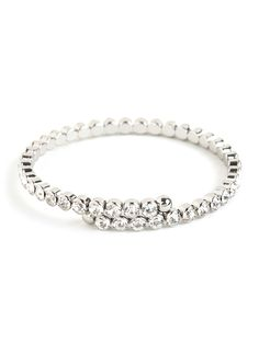 Looking for a more delicate take on glitz? Try this beauty on for size. With its single strand of faceted ice-white crystals, it's a truly elegant and refined way to go glamorous.