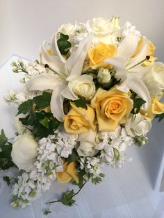 Lilies, Yellow and White Roses with White Stock and Ivy Bouquet