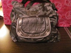 This hot little number will satisfy your every style craving    KATHY VAN ZEELAND    WOMENS    SILVER/GRAY/BROWN    CAMOUFLAGE SATCHEL/SHOULDER HANDBAG    VERY GOOD CONDITION    FOR PREOWNED    10 IN HEIGHT    12 IN LENGTH    9 IN DEEP    10.5 STRAP DROP    SILVER METAL EMBELLISHMENTS    ZIPPERED COMPARTMENTS    SLIDE POCKETS    PEN MARKS ON LINING    DOES NOT EFFECT THE    WEAR & TEAR OF THIS HANDBAG    SUPER CUTE    VERY ROOMY    WONDERFUL ADDITION    TO YOUR WARDROBE