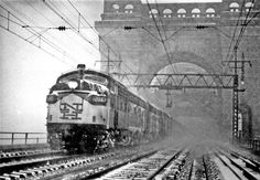 with Boston–New York (Penn Station) Hell Gate crossing Hell Gate Bridge during blizzard of Feb. Train Posters, Railroad Bridge, Railroad Pictures, Pennsylvania Railroad, Diesel Locomotive, Heavy Equipment, New York City, Cool Pictures, Vintage Trains
